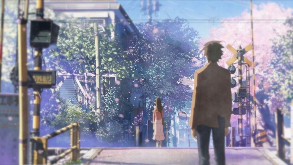 Takaki and Akari stood at opposite ends of a railroad crossing as sakura flowers fall around them